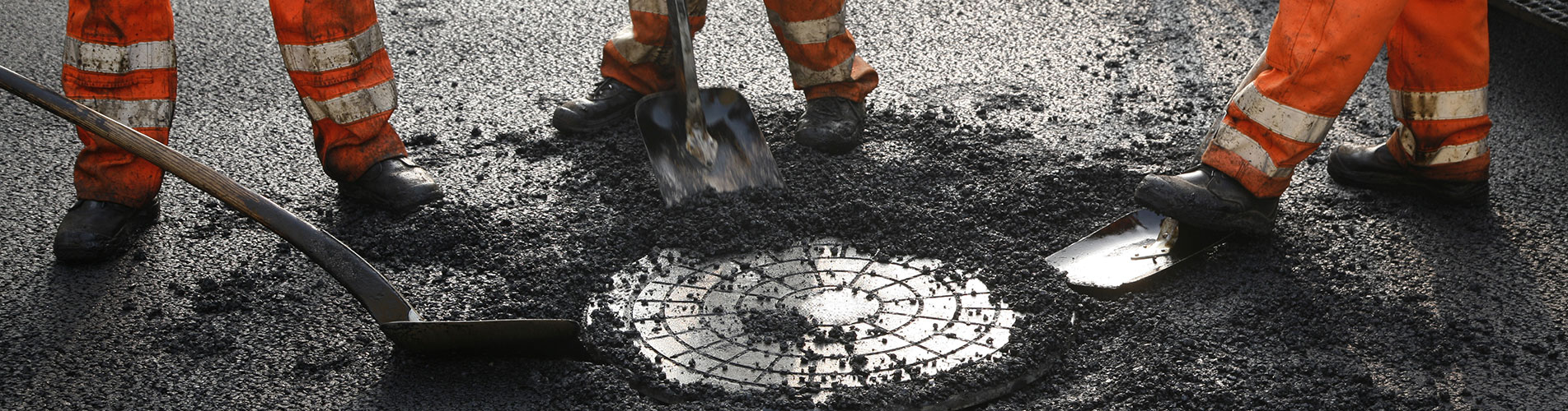asfaltwegen, inspectieputten